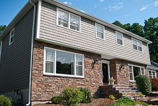 gray siding brick bottom