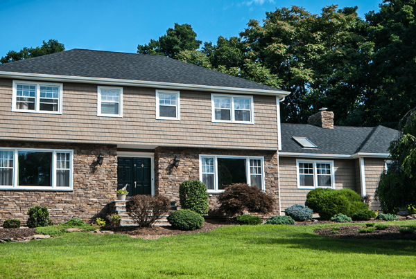 Beige vinyl siding and stone facade