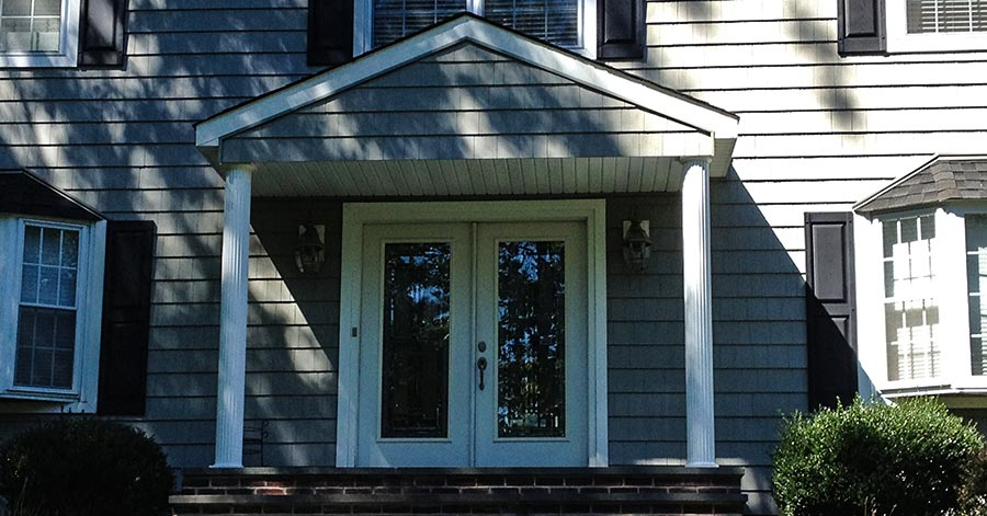 The Unsung Benefits Of A Portico Over Your Home's Entryway